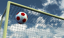 Soccer Foot Ball towards the goal net Stock Images