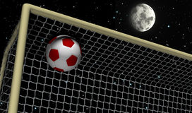 Soccer Foot Ball towards the goal net - Night scene Stock Photo