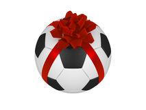Soccer footbal ball with red Christmas ribbon Stock Photo
