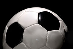Soccer - Football. Black and White Football - Soccer Ball on Black background royalty free stock image
