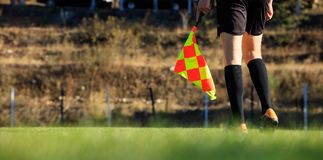 Soccer assistant referee on the field Royalty Free Stock Photo