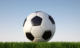Soccer/football  ball close -p on grass lawn. Royalty Free Stock Photography