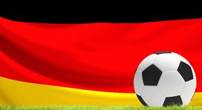 Soccer football ball with flag of Germany 3d rendering with gree. N lawn design Royalty Free Stock Image