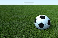 A soccer, a football ball on green grass field Royalty Free Stock Image