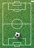 Soccer football ball on green grass of soccer field with line pattern. Soccer football ball on green grass of soccer field with line pattern and grass texture Stock Photos