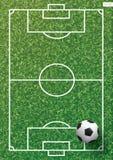 Soccer football ball on green grass of soccer field with line pattern. Soccer football ball on green grass of soccer field with line pattern and grass texture Stock Photo