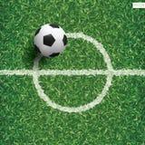 Soccer football ball on green grass of soccer field pattern. Soccer football ball on green grass of soccer field pattern and texture background with center line Stock Image