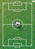 Soccer football ball on green grass of soccer field with line pattern. Soccer football ball on green grass of soccer field with line pattern and grass texture Stock Image
