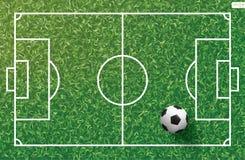 Soccer football ball on green grass of soccer field with line pattern. Soccer football ball on green grass of soccer field with line pattern and grass texture Stock Photography