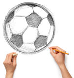 Soccer football ball and hand with pencil. Isolated on white background Stock Photo
