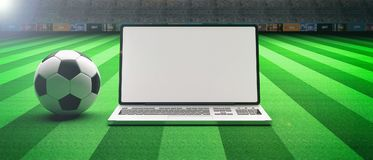 Soccer football ball and a laptop on a field background. 3d illustration. Soccer football ball and a computer on an illumunated field grass background. 3d Royalty Free Stock Image