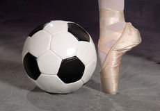 Soccer - Football and Ballet Shoe. On pointe royalty free stock photos