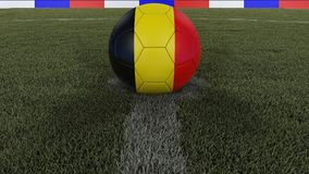 Soccer / football classic ball in the center of the field grass with painting of the Belgium flag with focus on the whole field, 3. Soccer / football classic Royalty Free Stock Photo