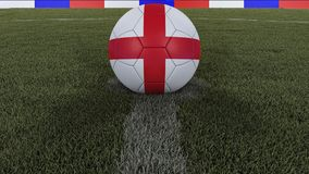 Soccer / football classic ball in the center of the field grass with painting of the England flag with focus on the whole field, 3. Soccer / football classic Stock Image