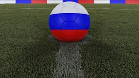 Soccer / football classic ball in the center of the field grass with painting of the Russia flag with focus on the whole field, 3D. Soccer / football classic Stock Photography