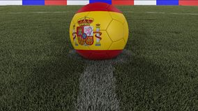 Soccer / football classic ball in the center of the field grass with painting of the Spain flag with focus on the whole field, 3D. Soccer / football classic ball Stock Photography