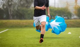 Soccer Football Endurance Training. Speed or Sprint Testing with Parachute. Professional Soccer Strength Test Stock Photos