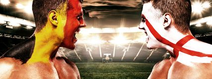Soccer or football fan athlete with bodyart on face - flag of Belgium vs England. Stock Photography