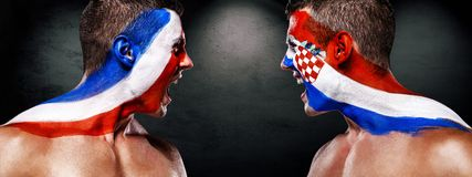 Soccer or football fan athlete with bodyart on face - flags of France vs Croatia. Sport Concept with copyspace. Final. Stock Images