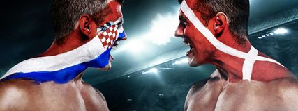 Soccer or football fan with bodyart on face with agression - flag of Croatia vs Denmark. Football of fan are cheering for their team victory stock photography