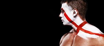 Soccer or football fan with bodyart on face with agression - flag of England. Football of fan are cheering for their team victory royalty free stock photography