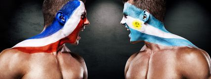 Soccer or football fan with bodyart on face with agression - flag of France vs Argentina. Football of fan are cheering for their team victory royalty free stock images