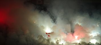 Soccer or football fans using pyrotechnics. Soccer or football fans celebrating goal using pyrotechnics during Serbian championship stock photography