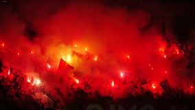 Soccer or football fans using pyrotechnics Stock Images