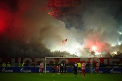 Soccer or football fans using pyrotechnics Stock Photo