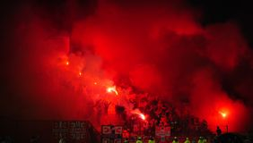 Soccer or football fans using pyrotechnics Royalty Free Stock Photos