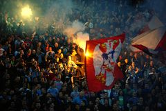 Soccer or football fans using pyrotechnics Royalty Free Stock Photo
