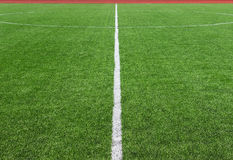 Soccer football field divided with white line. Soccer football field center divided with white line Stock Image