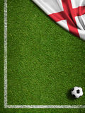 Soccer or football field with flag of England. Soccer field with ball and flag of England Stock Photography