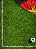 Soccer or football field with flag of Germany. Soccer field with ball and flag of Germany Stock Images