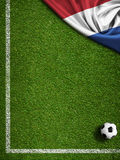 Soccer or football field with flag of Nederland Royalty Free Stock Images