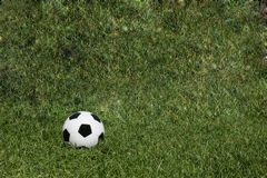 Soccer ball on grass fields Royalty Free Stock Photo
