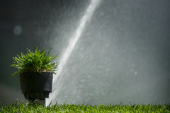 Soccer or football field irrigation system of automatic watering grass Royalty Free Stock Photos