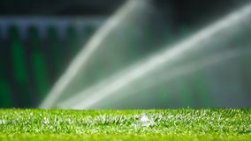 Soccer or football field irrigation system of automatic watering grass. stock footage