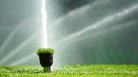 Soccer or football field irrigation system of automatic watering grass. stock video footage
