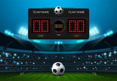 Soccer football field with scoreboard and spotlight Stock Photography