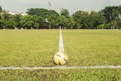 Football is on the white line in the field. Royalty Free Stock Photos