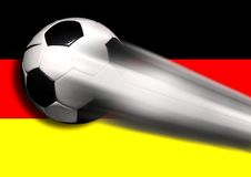 Soccer - Football Flying with German Flag. Soccer - football on black stock image