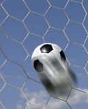 Soccer - football in Goal. With blurred streak stock images