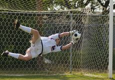 Soccer Football Goal Keeper making Save. Soccer Football Goalie making diving save stock image