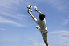 Soccer Football Goal Keeper making Save. Soccer Football Goalie making diving save stock images