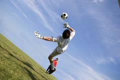 Soccer Football Goal Keeper making Save. Soccer Football Goalie making diving save stock photography