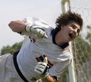 Soccer Football Goal Keeper straining for Save. Soccer Football Goalie making diving save stock photography