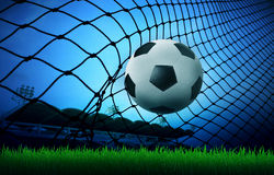 Soccer football in goal Royalty Free Stock Photo
