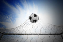 Soccer football in Goal net Royalty Free Stock Image
