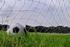 Soccer football in Goal net Royalty Free Stock Image